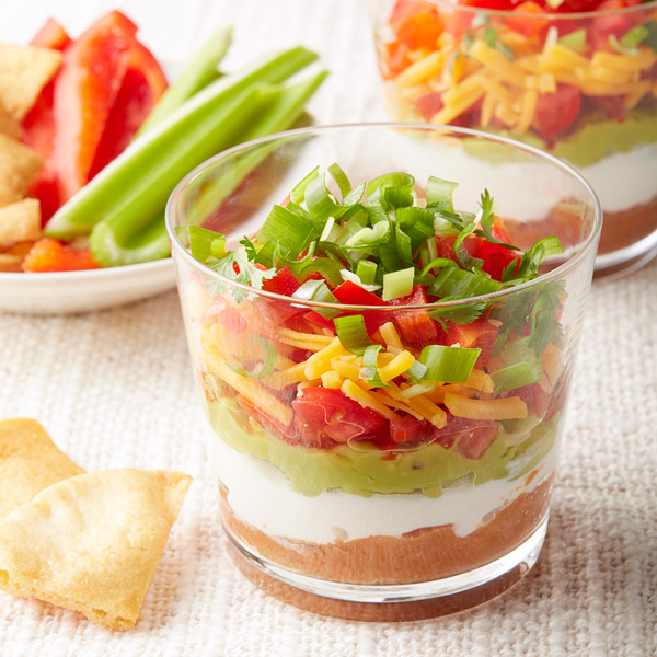 I'd consider these Mini Mexican 7 Layer Dipsa party must-have! They stay pretty and allow for double-dipping with wanton abandon. Even better? This one is a Weight Watchers recipe so it's sneaky-light too...shhhh!
