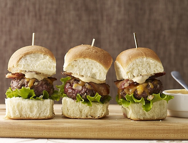 Burgers are a tailgate-style staple & sliders are the perfect snack-sized option for party noshing.  My Bacon Cheddar Sliders with Chipotle Sauce totally bring it!